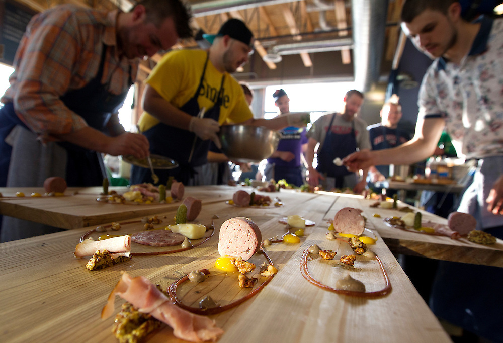An artistic assembly line of chefs assembles charcuterie boards at Travail in Robbinsdale April 18, 2014.