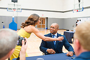 Dallas Wings head coach Fred Williams gets a hug from Skylar Diggins as he visits with the media during the team media day in Arlington, Texas on May 5, 2016.  (Cooper Neill for The New York Times)