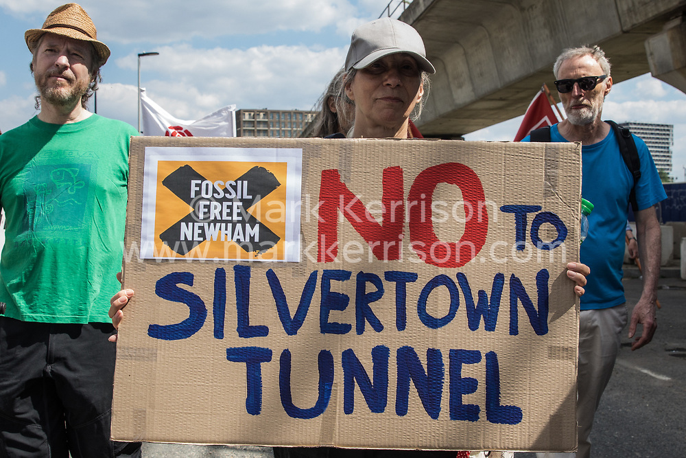 An environmental activist from Fossil Free Newham joins local residents protesting against the construction of the Silvertown Tunnel on 5th June 2021 in London, United Kingdom. Campaigners opposed to the controversial new £2bn road link across the River Thames from the Tidal Basin Roundabout in Silvertown to Greenwich Peninsula argue that it is incompatible with the UK's climate change commitments because it will attract more traffic and so also increased congestion and air pollution to London's most polluted borough.