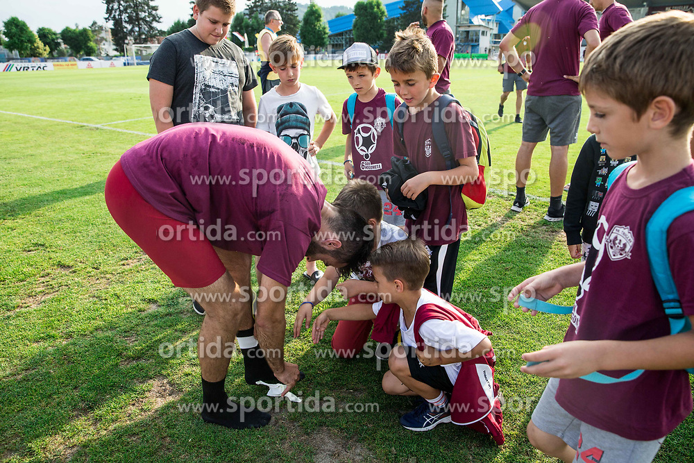 Momir Bojic of Triglav giving socs to his young fans after winning during 2nd Leg football match between NK Triglav Kranj and NS Drava Ptuj in Qualifications of Prva Liga Telekom Slovenije 2018/19, on June 6, 2018 in Kranj, Slovenia. Photo by Vid Ponikvar / Sportida