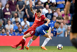 Liverpool's Dejan Lovren (left) and Chelsea's Eden Hazard battle for the ball during the Premier League match at Stamford Bridge, London.