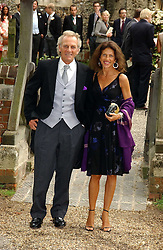 MARK SHAND brother of Camilla Parker Bowles and his wife CLEO at the wedding of Tom Parker Bowles to Sara Buys at St.Nicholas Church, Rotherfield Greys, Oxfordshire on 10th September 2005.<br />