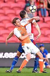 October 22, 2017 - Brisbane, QUEENSLAND, AUSTRALIA - Nigel Boogaard of the Jets (#4t) and Brett Holman of the Roar (#10) compete for the ball during the round three Hyundai A-League match between the Brisbane Roar and the Newcastle Jets at Suncorp Stadium on October 22, 2017 in Brisbane, Australia. (Credit Image: © Albert Perez via ZUMA Wire)