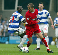 PHOTO: GERARD FARRELL<br /> QPR V STOCKPORT.<br /> NATIONWIDE DIVISION TWO.<br /> DATE: 17\04\2004.<br /> SWINDONS ANDY GURNEY WITH THE BALL WITH QPR'S PAUL FURLONG