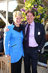 CLARE BALDING and MR JOHN MADEJSKI the multi millionaire chairman of the Madejski Stadium in Reading,  at the Royal Windsor Charity Race Evening in aid of the Great Ormond Street Hospital Children's Charity held at Windsor Racecourse, Berkshire on 5th July 2004.
