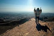 Israel, Negev Desert, Jewish man praying in front of an awe inspiring landscape at dawn,