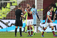 Andy Carroll of West Ham United  reacts as he gets frustrated and argues with Referee Kevin Friend. Premier league match, West Ham Utd v Manchester city at the London Stadium, Queen Elizabeth Olympic Park in London on Wednesday 1st February 2017.<br /> pic by John Patrick Fletcher, Andrew Orchard sports photography.