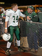 Cornwall football player Pat Harris, left, celebrates with Dan Woederman, the father of player Kevin Woerderman, after Cornwall beat Harrison in a Class A state quarterfinal game at Mahopac High School on Nov. 10, 2006.