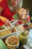 restaurnat Hier et Aujourd'hui, Paris 17th..Chef Franck Dervin..Hostess Karin Ouet..Paté and pickles (cornichons) served right away.....Photograph by Owen Franken...... - Photograph by Owen Franken