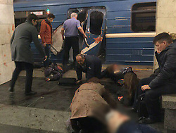 April 3, 2017 - Saint Petersburg, Russia - Moments after the blast people on the ground as others rush to help injured in the subway train. At least 10 people have been killed after an explosion on the Saint Petersburg's Sennaya metro station. (Credit Image: © Russian Look via ZUMA Wire)