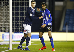 February 12, 2019 - London, England, United Kingdom - L-R Jake Cooper of Millwall  and Sheffield Wednesday's Michael Hector.during Sky Bet Championship match between Millwall and Sheffield Wednesday at The Den Ground, London on 12 Feb 2019. (Credit Image: © Action Foto Sport/NurPhoto via ZUMA Press)