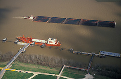 Aerial view of a barge and tankers on the water