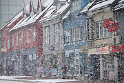 Snow shower and street scene in the city of Tromso, near the Arctic Circle in Northern Norway