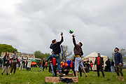 Residents of Napier Barracks and locals play volleyball together as 200 campaigners from different local groups came together today for a festival of solidarity with residents of Napier Barracks, a former military barracks that is being used as an assessment and dispersal facility for asylum seekers by the Home Office on the 21st of May 2021 in Folkestone, Kent, United Kingdom.