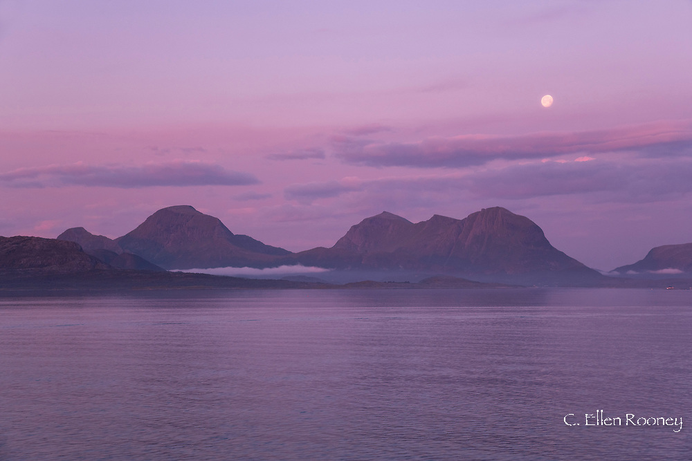 Dramatic scenery and a moonset on the northwest coast of Norway north of Kristiansund, Nord-Trondelag, Norway, Europe