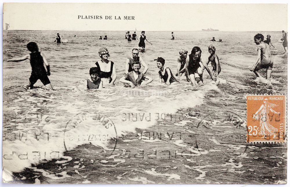 photo postcard with people having fun in the sea 1920s
