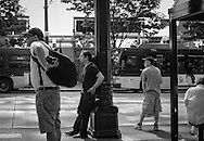 2013 June 30 - Men wait at a bus stop along 3rd Avenue, Seattle, WA. By Richard Walker