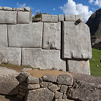 One of the walls of the temple of the three windows at the sacred plaza. The Incas cut the stones into blocks and fitted them tightly together without using mortar or any other binding material.
