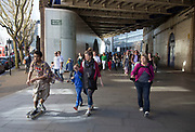 People arrive in the area from Waterloo station, passing underneath a railway bridge and towards the area behind the Festival Hall. The South Bank is a significant arts and entertainment district, and home to an endless list of activities for Londoners, visitors and tourists alike.