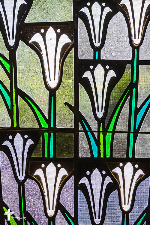 Stained glass depicting lilies (Matthew 6:28) on Sunday, Aug. 2, 2020, at Elm Grove Lutheran Church, Elm Grove, Wis. LCMS Communications/Erik M. Lunsford