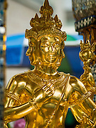 03 SEPTEMBER 2015 - BANGKOK, THAILAND: The repaired Four Faced Brahma statue at Erawan Shine Repairs to Erawan Shrine were completed Thursday, Sept 3 after the shrine was bombed on August 17. Twenty people were killed in the bombing and more than 100 injured. The statue of the Four Faced Brahma in the shrine was damaged by shrapnel and a building at the shrine was damaged by debris.      PHOTO BY JACK KURTZ