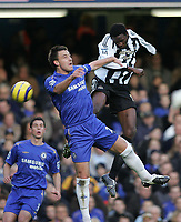 Photo: Lee Earle.<br /> Chelsea v Newcastle United. The Barclays Premiership.<br /> 19/11/2005. Chelsea's John Terry (L) and Shola Ameobi battle in the air.