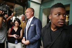 Family spokesman and activist Ja'Mal Green, right, and attorney Michael Oppenheimer speak one-on-one to journalists following a press conference after viewing the the dashcam and bodycam video from the July 28 police shooting death of Paul O'Neal with O'Neal's family Friday, August 5, 2016 at IPRA headquarters in Chicago, IL, USA. Photo by Anthony Souffle/Chicago Tribune/TNS/ABACAPRESS.COM