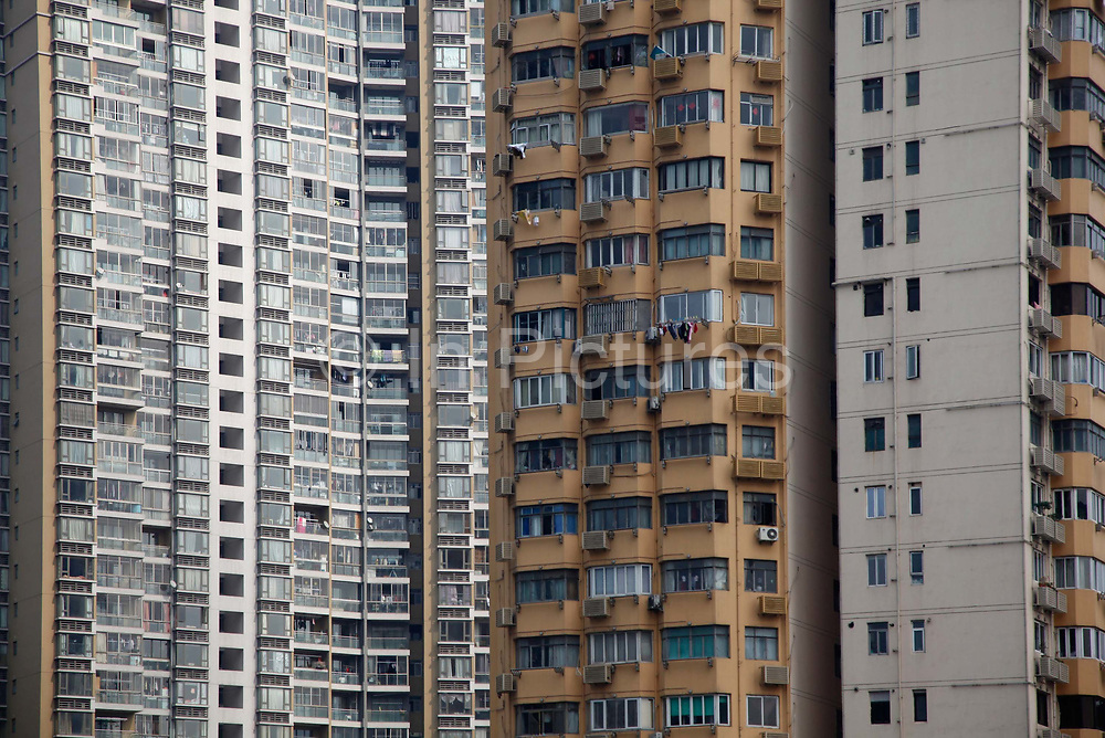 """A view of densely pupulated apartment blocks in Shanghai, China on 14 February, 2011.  While the latest introduction of property tax by the central government has yet to show its cooling effects on asset prices,  it is providing extra impetus for rent increases in many Chinese cities, according to a survey conducted by China Youth Daily. In the survey, 81.6 per cent of the 4,060 respondents interviewed said they """"are suffering from the increase in rents"""". Among them, 34.8 per cent said their quality of life has been """"greatly affected by the increase""""."""
