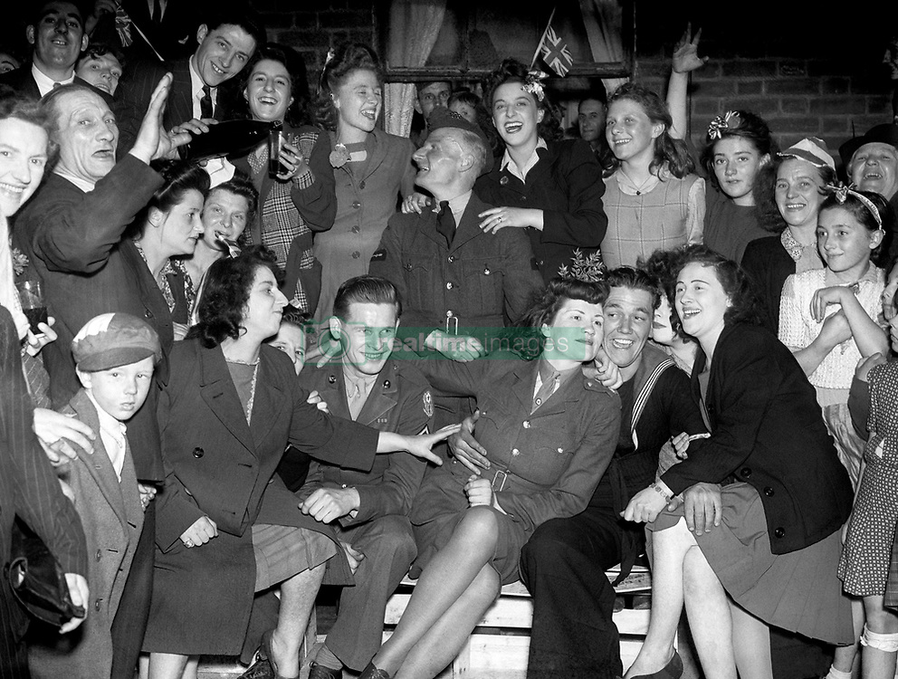 File photo dated 08/05/45 of VE (Victory in Europe) Day celebrations in the East End of London, marking the end of the war in Europe. A teenage Princess Elizabeth danced in jubilation on VE Day after slipping into the crowds unnoticed outside Buckingham Palace.