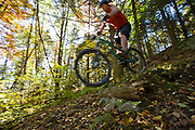 Stowe, Vermont - Mountain biking in fall foliage.