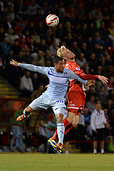Coventry City's Jordan Clarke and Leyton Orient's Jayden Stockley compete for the ball - Photo mandatory by-line: Mitchell Gunn/JMP - Tel: Mobile: 07966 386802 08/10/2013 - SPORT - FOOTBALL - Brisbane Road - Leyton - Leyton Orient V Coventry City - Johnstone Paint Trophy