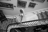 Bride walking down the stairs at Deer Park Country House