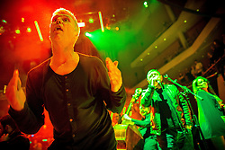 """© Licensed to London News Pictures . 05/02/2016 . Manchester , UK . BEZ . """" Hacienda Classical """" debut at the Bridgewater Hall . The 70 piece Manchester Camerata and performers including New Order's Peter Hook , Shaun Ryder , Rowetta Idah , Bez and Hacienda DJs Graeme Park and Mike Pickering mixing live compositions . Photo credit : Joel Goodman/LNP"""