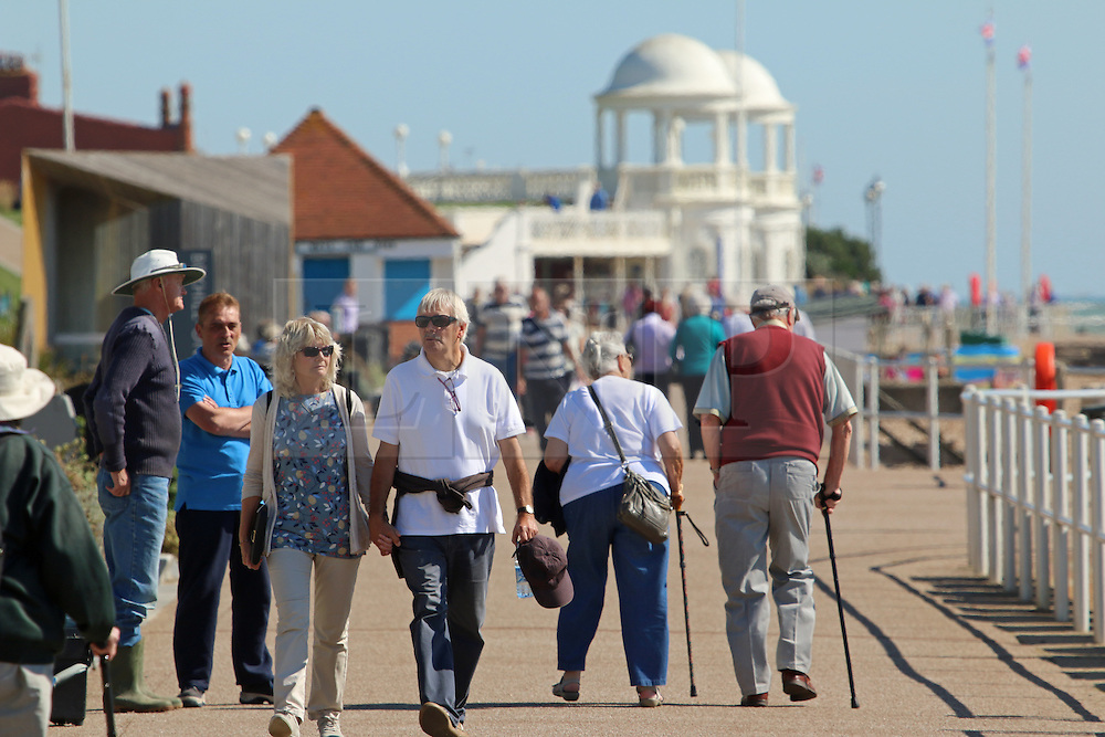 © Licensed to London News Pictures. 10/09/2015. East Sussex.  People on the Bexhill sea front with the De La Warr pavillion behind . The country has enjoyed high temperatures and sunny weather today as summer draws to a close. Credit : Rob Powell/LNP