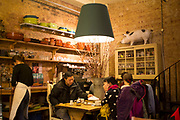 Interior of Patisserie Lila in Borough Market, London, UK. A traditional yet ecclectically decorated cafe.
