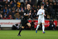 referee Anthony Taylor in action. Premier league match, Swansea city v Burnley at the Liberty Stadium in Swansea, South Wales on Saturday 4th March 2017.<br /> pic by Andrew Orchard, Andrew Orchard sports photography.