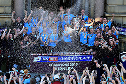 Burnley players spray champagne and lift the SkyBet Championship Winners trophy in front of their fans outside the Town Hall - Mandatory by-line: Matt McNulty/JMP - 09/05/2016 - FOOTBALL - Burnley Town Hall - Burnley, England - Burnley FC Championship Trophy Presentation