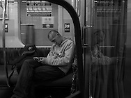 July 9, 2016, Tokyo Japan: Fellow commuter riding the last train from the burbs back into Tokyo just after midnight. On my headphones I was listening to Leonard Cohen. Photo by Torin Boyd