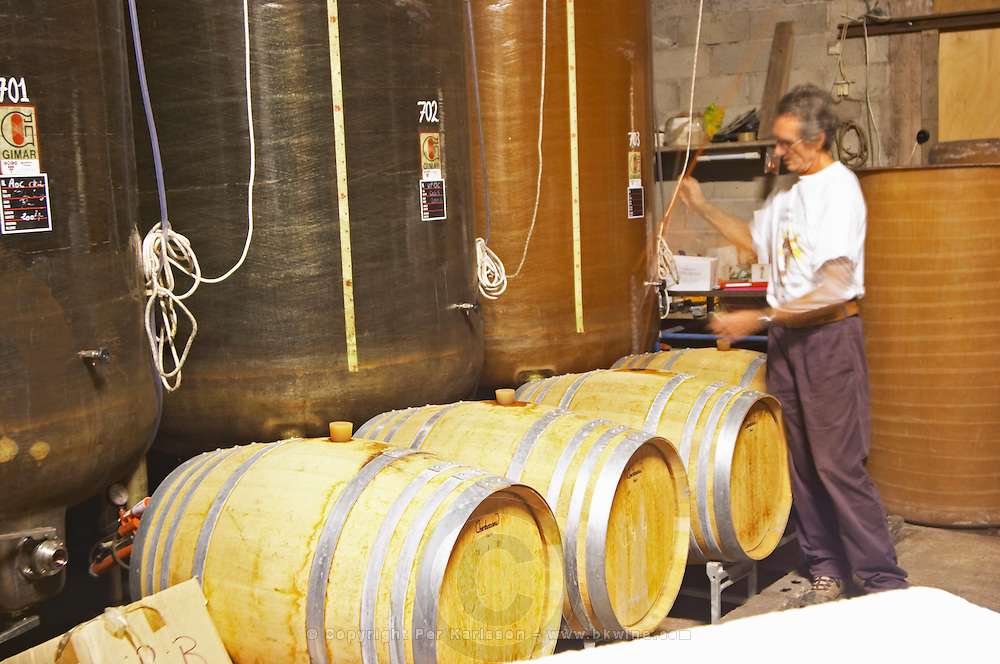 Michel Moreau Domaine de Terre Megere, Cournonsec, Montpellier. Gres de Montpellier. Languedoc. Barrel cellar. Batonnage, stirring of the lees with a stave. France. Europe.