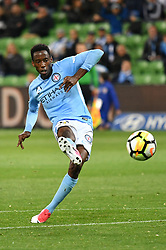 October 6, 2017 - Melbourne, Victoria, Australia - BRUCE KAMAU (11) of Melbourne City kicks a goal in the round one match of the A-League between Melbourne City and Brisbane Roar at AAMI Park, Melbourne, Australia. Melbourne won 2-0 (Credit Image: © Sydney Low via ZUMA Wire)