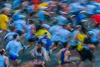PARIS , FRANCE - APRIL 14 : marathon runners at Paris International Marathon on April 14 , 2006 in Paris, France