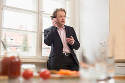 Man in suit on the phone at home