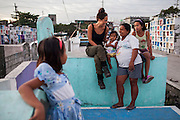 (L-R) Christine Joy, 9, UK celebrity Myleene Klass, Carla Mae, 2, Rose Marie Ferrer, 33, and Charlene, 11, pose for a group portrait in an inhabited cemetery where they live in Paranaque City, Metro Manila, The Philippines on 18 January 2013. Myleene Klass had come to visit Rose who owns a shop in the cemetery where she sells funeral items. She supports her family with this, has breastfed all her 5 children, and is 9 months pregnant now. Photo by Suzanne Lee for Save the Children UK