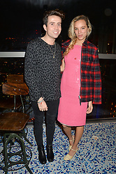 NICK GRIMSHAW and PHOEBE COLLINGS-JAMES at a party to celebrate the first anniversary of SushiSamba at the Heron Tower, 110 Bishopsgate, London EC4 on 12th November 2013.