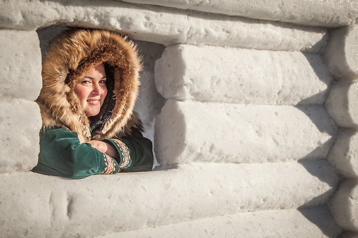"""Alaya Burg inside a snow log house at the GCI Rondy Snow Sculpture Competition.  """"I grew up in Anchorage an am Athabaskin and Yup'ik.""""   Aiamalaya84@gmaiol.com"""