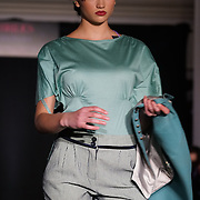 London,England,UK : 6th May 2016 : A model wearing Designer DePLOY demi-couture and Hat Designer by Hennumi latest Spring-Summer Brides Catwalk Show & Style Event at Strand, London. Photo by See Li