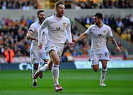 Charlie Taylor celebrates scoring first goal during the Sky Bet Championship match between Wolverhampton Wanderers and Leeds United at Molineux, Wolverhampton, England on 6 April 2015. Photo by Alan Franklin.