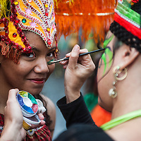 London, UK - 25 August 2014: a reveller puts make up on during the Notting Hill Carnival in London.