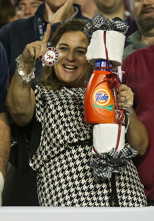 """January 7, 2013:  Alabama fan with her """"Roll Tide"""" during the Discover BCS National Championship between the Alabama Crimson Tide and the Notre Dame Fighting Irish at Sun Life Stadium in Miami Gardens, Florida.  Alabama defeated Notre Dame 42-14."""