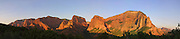 The Kolob Canyons of Zion National Park, Utah, are turned golden red by the setting sun in this panoramic view.